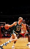 Larry Bird of the Boston Celtics drives to the basket as Dominique Wilkins of the Atlanta Hawks defends during the game against the Atlanta Hawks in...