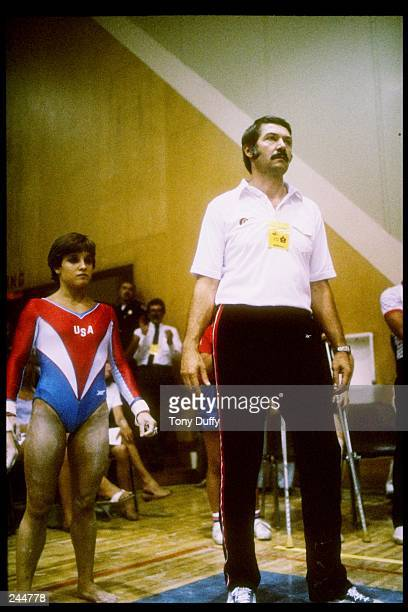 Mary Lou Retton of the United States stands with her coach Bela Karolyi Mandatory Credit Tony Duffy /Allsport