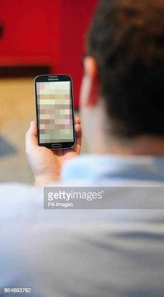 Undated photo of a man looking at a mobile phone Clarification is needed on the law around 'revenge porn' and when it could lead to a prosecution a...