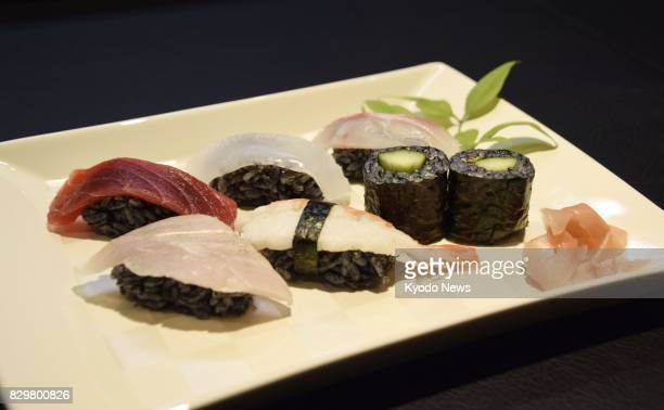 Undated photo shows sushi made with black rice as it is mixed with black bamboo charcoal powder offered at a restaurant in a mall in Yawatahama in...