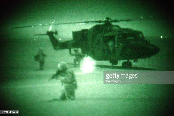 Undated photo taken at night using Night Vision Goggles of members of 3rd Regiment Air Assault Corps 16 Air Assault Brigade at Camp Eagle Kuwait A...