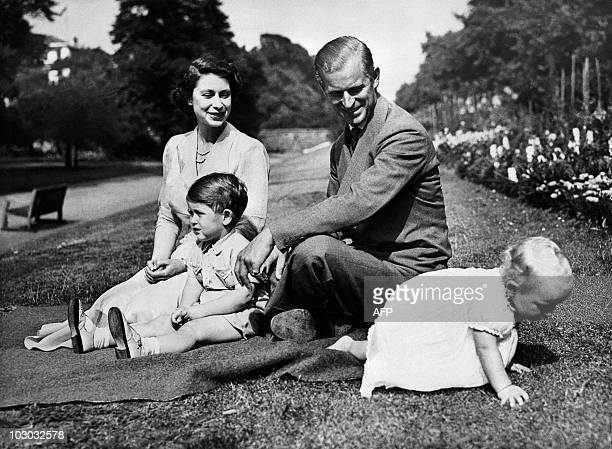 Undated picture showing the Royal British couple Queen Elizabeth II and her husband Philip Duke of Edinburgh with their two children Charles Prince...