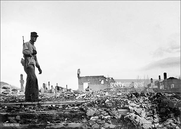 Undated picture taken in Hamhung Korea shows an US soldier walking among the ruins of the city