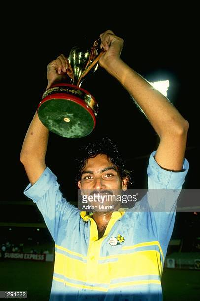 Ravi Shastri of India holds the Man of the Series World Championship Trophy aloft Mandatory Credit Adrian Murrell/Allsport