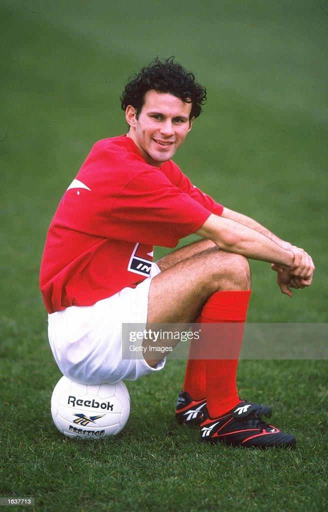 <a gi-track='captionPersonalityLinkClicked' href=/galleries/search?phrase=Ryan+Giggs&family=editorial&specificpeople=201666 ng-click='$event.stopPropagation()'>Ryan Giggs</a> of Wales sits on a ball. \ Mandatory Credit: Allsport UK /Allsport
