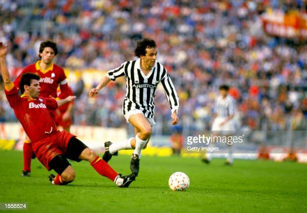 Sebastiano Nela of Roma AS tackles Michel Platini of Juventus during a match at the Delle Alpi Stadium in Turin Italy Mandatory Credit Allsport UK...