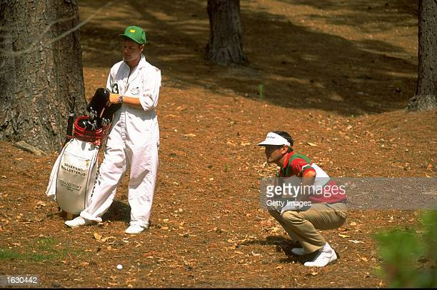 Seve Ballesteros of Spain plays from the trees during the US Masters at the Augusta National Golf Club in Georgia USA Mandatory Credit Allsport UK...