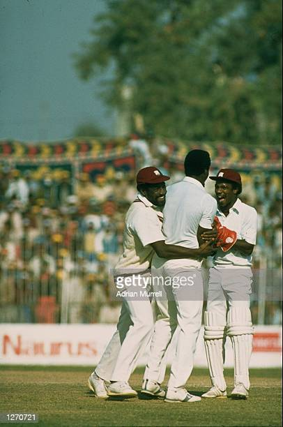 Viv Richards and Derek Murray of the West Indies congratulate team mate Sylvester Clarke after bowling out Zaheer Abbas of Pakistan during the Second...
