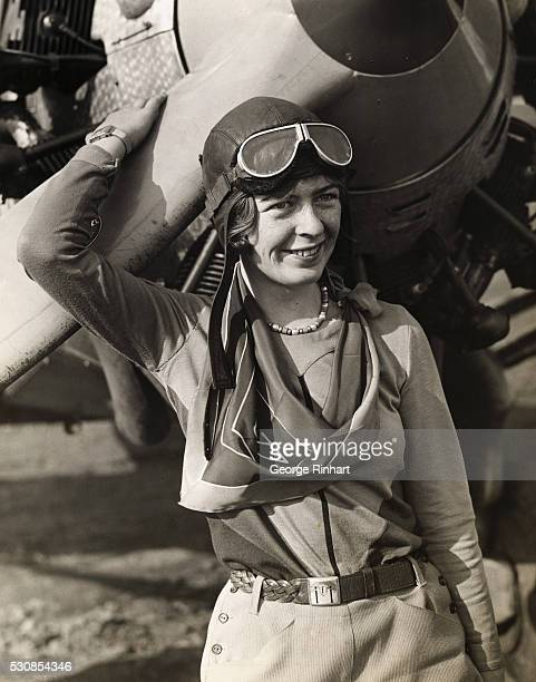 Undated waistup picture of pilot Eleanor Smith leaning on the propeller of her airplane