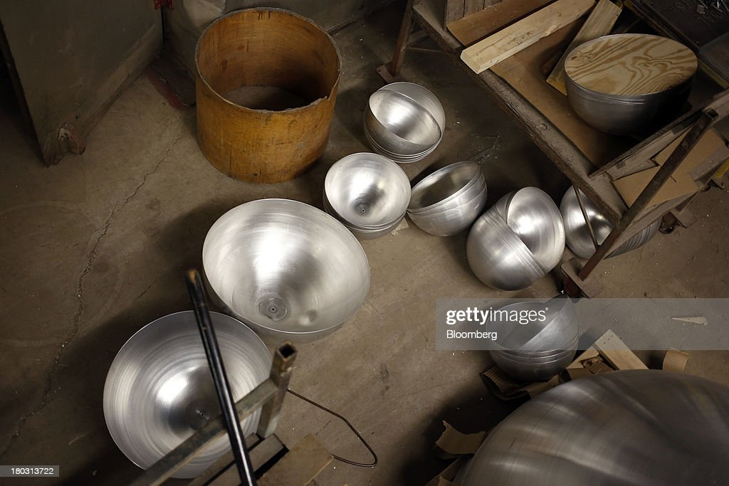 Undecorated disco ball halves sit at the Omega National Products manufacturing facility in Louisville, Kentucky, U.S., on Tuesday, Sept. 10, 2013. The U.S. Federal Reserve is scheduled to release industrial production figures on Sept. 16. Photographer: Luke Sharrett/Bloomberg via Getty Images