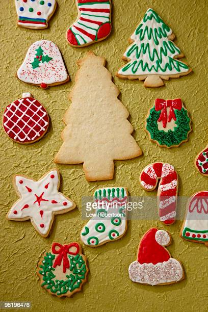Undecorated sugar cookie among iced cookies