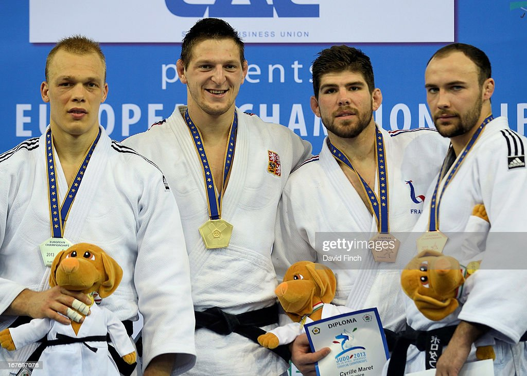 silver medalist <a gi-track='captionPersonalityLinkClicked' href=/galleries/search?phrase=Henk+Grol&family=editorial&specificpeople=4920749 ng-click='$event.stopPropagation()'>Henk Grol</a> (Holland), gold medalist <a gi-track='captionPersonalityLinkClicked' href=/galleries/search?phrase=Lukas+Krpalek&family=editorial&specificpeople=6589582 ng-click='$event.stopPropagation()'>Lukas Krpalek</a> (Czech Republic), bronze medalists Cyrille Maret (France) and <a gi-track='captionPersonalityLinkClicked' href=/galleries/search?phrase=Jevgenijs+Borodavko&family=editorial&specificpeople=5489212 ng-click='$event.stopPropagation()'>Jevgenijs Borodavko</a> (Latvia) during the Budapest European Championships at the Papp Laszlo Sports Hall on April 27, 2013 in Budapest, Hungary.