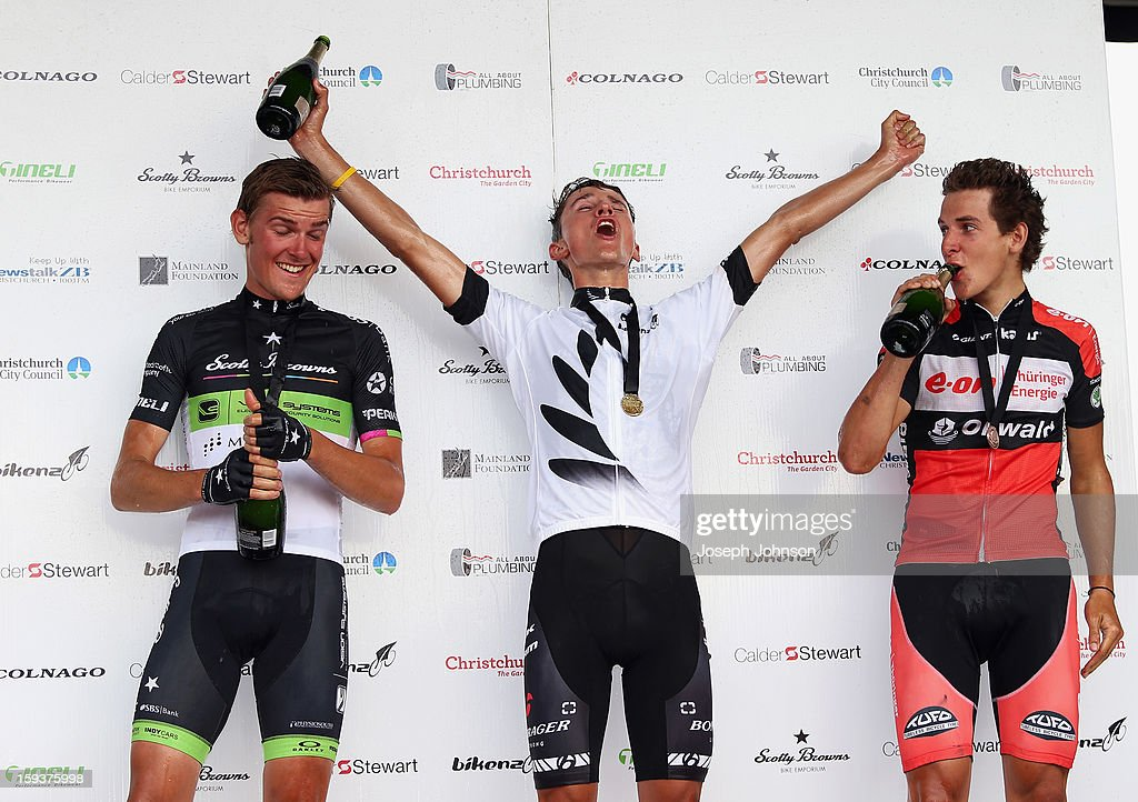 Under 23 winner James Oram celebrates on the podium with in second Michael Vink and in third Alex Frame after the Men's Road Race during the New Zealand Road Cycling Championships at Pioneer Stadium on January 13, 2013 in Christchurch, New Zealand.