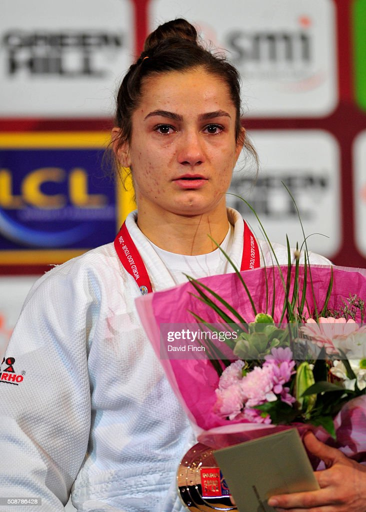 Under 52kg gold medallist Majlinda Kelmendi of Kosovo stands respectfully during the Kosovo national anthem at the 2016 Paris Judo Grand Slam on...