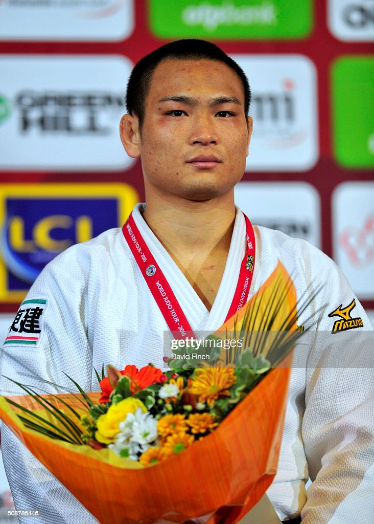 Under 66kg gold medallist Masashi Ebinuma of Japan stands respectfully during the Japanese national anthem at the 2016 Paris Judo Grand Slam on...