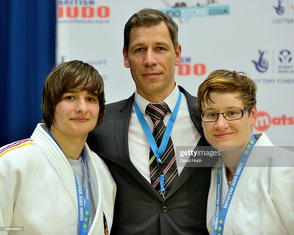 Under 70kgs bronze medallists Melanie Gerber Anne Ritt of Germany and their coach during day 2 of the London British Open Judo Championships at the K2 on May 12, 2013 in Crawley, United Kingdom.