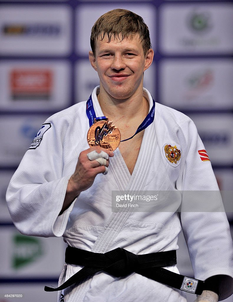 Under 81kg medallist Ivan Nifontov of Russia poses with his bronze medal during the Chelyabinsk Judo World Championships at the Sport Arena 'Traktor' on August 28, 2014 in Chelyabinsk, Russia.