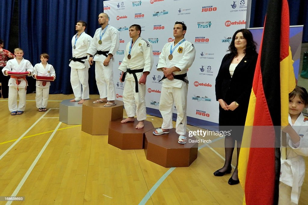 Silver: Massimiliano Carollo (Italy), Gold: Faruch Bulekulov (Germany), Bronzes: Aleksei Fetisov (Russia) and Sven Maresch (Germany) with the medals presented by Lisa Allan of the IJF during day 2 of the London British Open Judo Championships at the K2 on May 12, 2013 in Crawley, United Kingdom.
