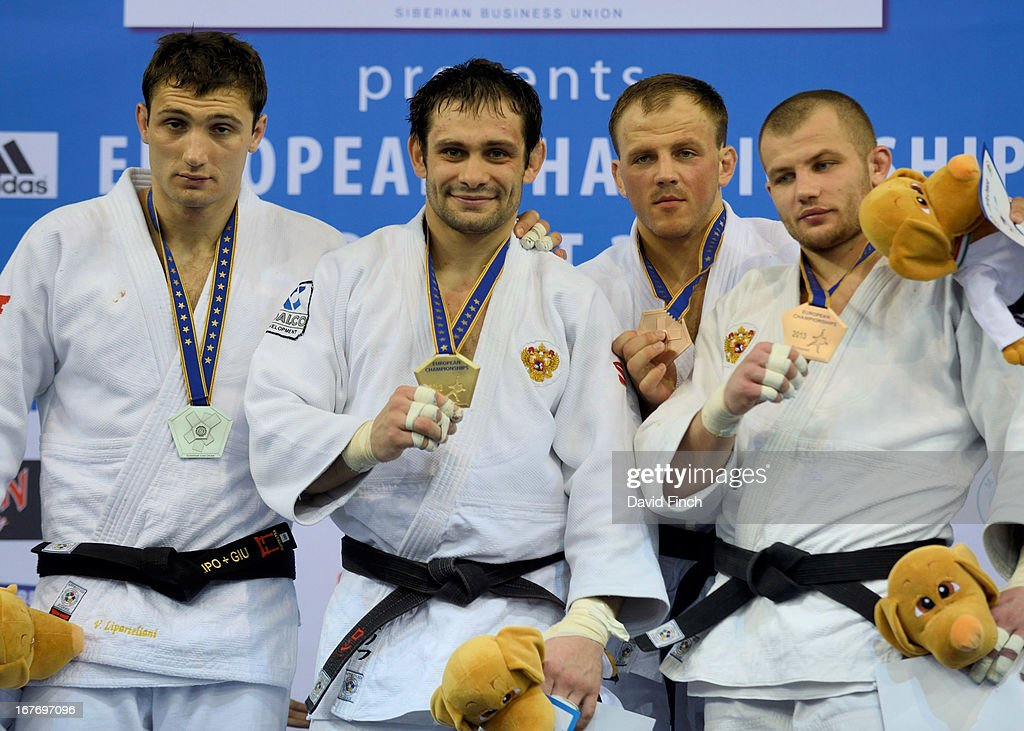 silver medalist Varlam Liparteliani (Georgia), gold medalist <a gi-track='captionPersonalityLinkClicked' href=/galleries/search?phrase=Kirill+Denisov&family=editorial&specificpeople=5957962 ng-click='$event.stopPropagation()'>Kirill Denisov</a> (Russia), bronze medalists Karolis Bauza (Lithuania) and Kirill Voprosov (Russia) during the Budapest European Championships at the Papp Laszlo Sports Hall on April 27, 2013 in Budapest, Hungary.