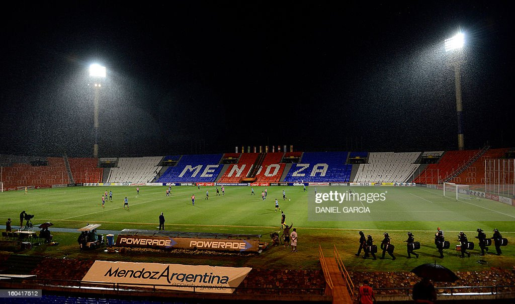 Under a heavy rain Paraguay and Uruguay play their South American U-20 final round football match at Malvinas Argentinas stadium in Mendoza, Argentina, on January 30, 2013. Four teams will qualify for the FIFA U-20 World Cup Turkey 2013.