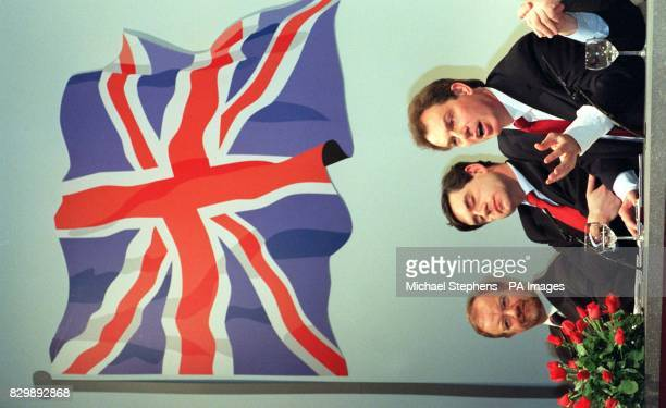 Under a huge Union Jack image Labour leader Tony Blair flanked by shadow Chancellor Gordon Brown and shadow Foreign Secretary Robin Cook answers a...