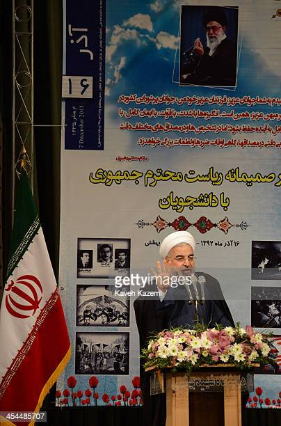Under a portrait of Iran's supreme leader Ayatollah Ali Khamenei president Hasan Rouhani makes a speech to hardline Basiji and reformist students at...