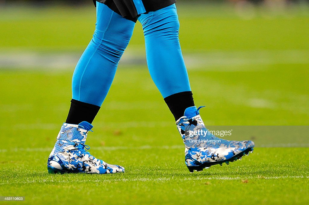 Under Armour cleats worn by Cam Newton of the Carolina Panthers against the New England Patriots during play at Bank of America Stadium on November...