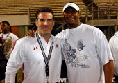 Under Armour founder and president Kevin Plank along with MLB player Ken Griffey Jr pose for a photo at the All America Under Armour Football Game at...