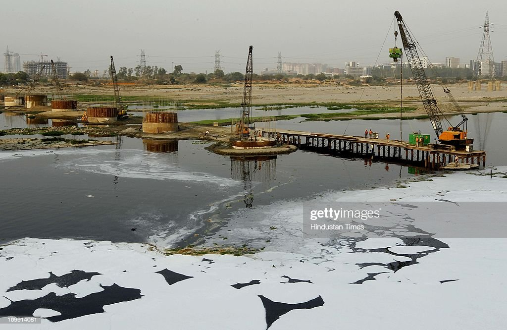 Under construction Metro rail bridge over polluted Yamuna river on June 4 2013 in New Delhi India World Environment Day is an annual event celebrated...