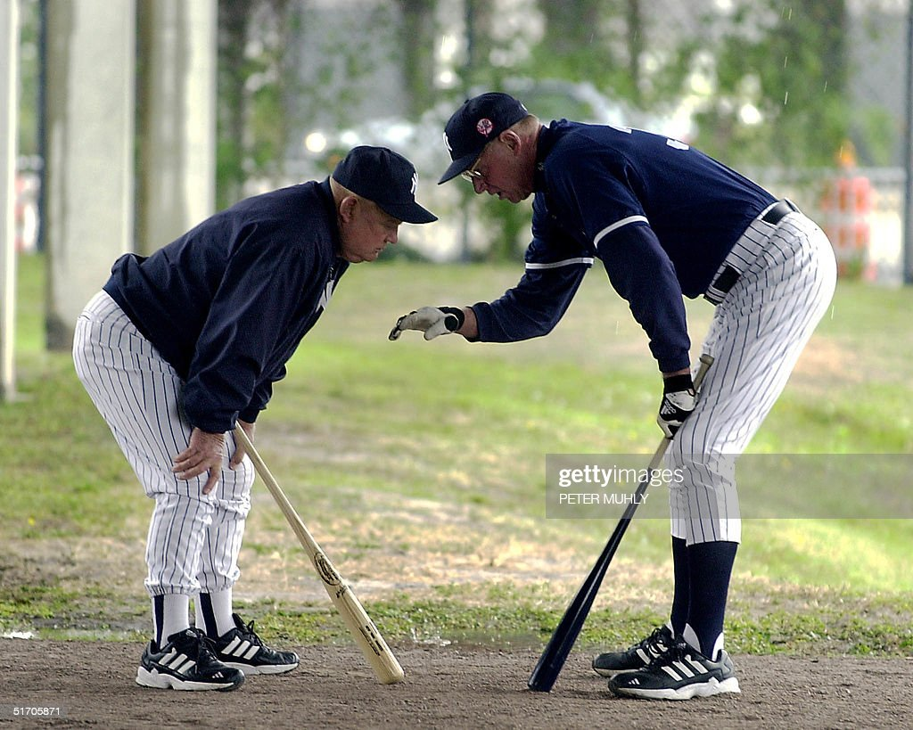 Under cover from the rain, New York Yankees coach <a gi-track='captionPersonalityLinkClicked' href=/galleries/search?phrase=Don+Zimmer&family=editorial&specificpeople=215376 ng-click='$event.stopPropagation()'>Don Zimmer</a> (L) and player development coach <a gi-track='captionPersonalityLinkClicked' href=/galleries/search?phrase=Frank+Howard+-+Baseball+Outfielder&family=editorial&specificpeople=14558717 ng-click='$event.stopPropagation()'>Frank Howard</a> discuss the mechanics of baseball 22 February 2002 during a rained out spring training at Legends Field in Tampa, Fl. This is the fourth day of spring training for the full squad. AFP PHOTO/ Peter MUHLY