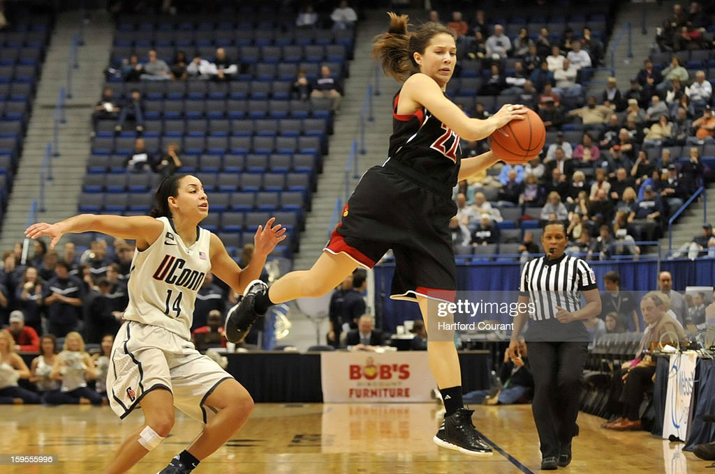 Under defensive pressure from Bria Hartley, left, of the Connecticut Huskies, Jude Schimmel of the Louville Cardinals grabs a pass to move the ball down court during the second half of a women's college basketball game at the XL Center on Tuesday, January 15, 2013, in Hartford, Connecticut.