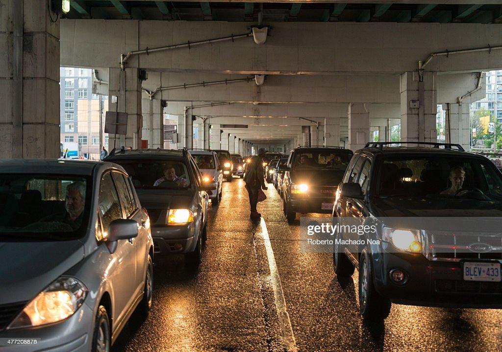 Gardiner Expressway : Under gardiner expressway in toronto downtown a person