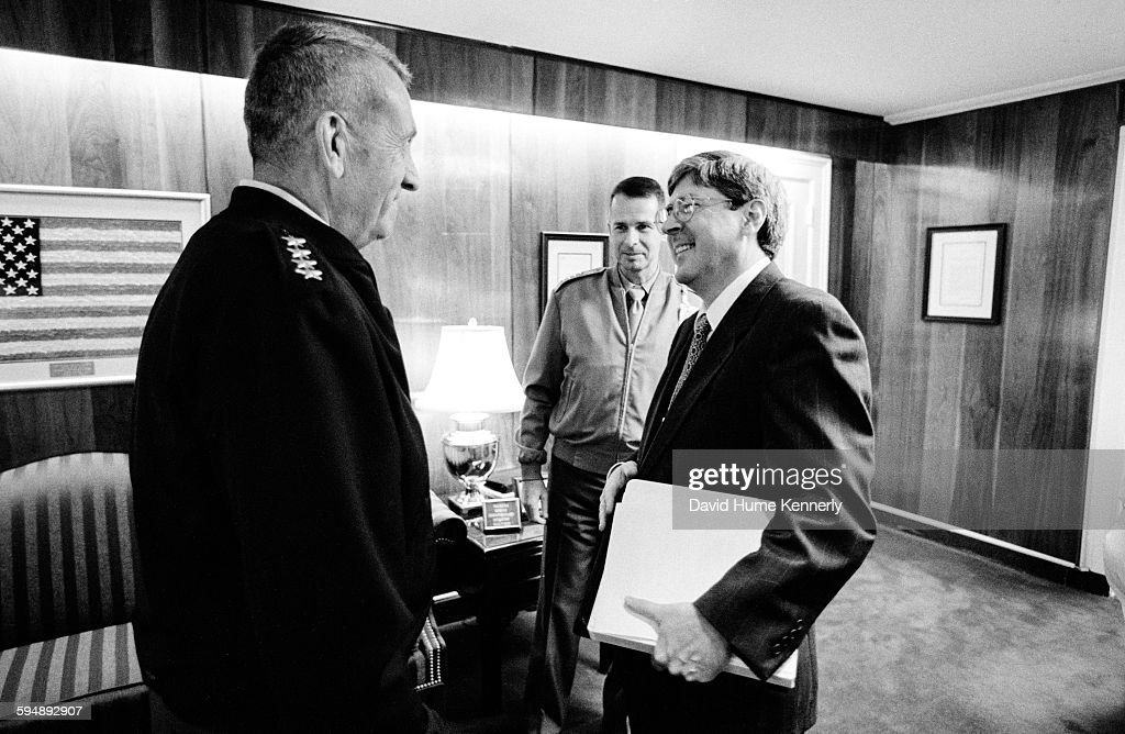 Under Secretary of Defense for Policy Douglas Feith talks to General Tommy Franks at the Pentagon September 5 2002 in Washington DC