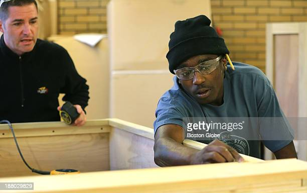 Under the eye of carpentry department head and lead instructor Brian Vogt left Keimody Crockett works on a bookcase on Monday November 4 2013...