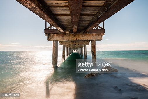 Under the jetty in Marbella at midday : Foto de stock