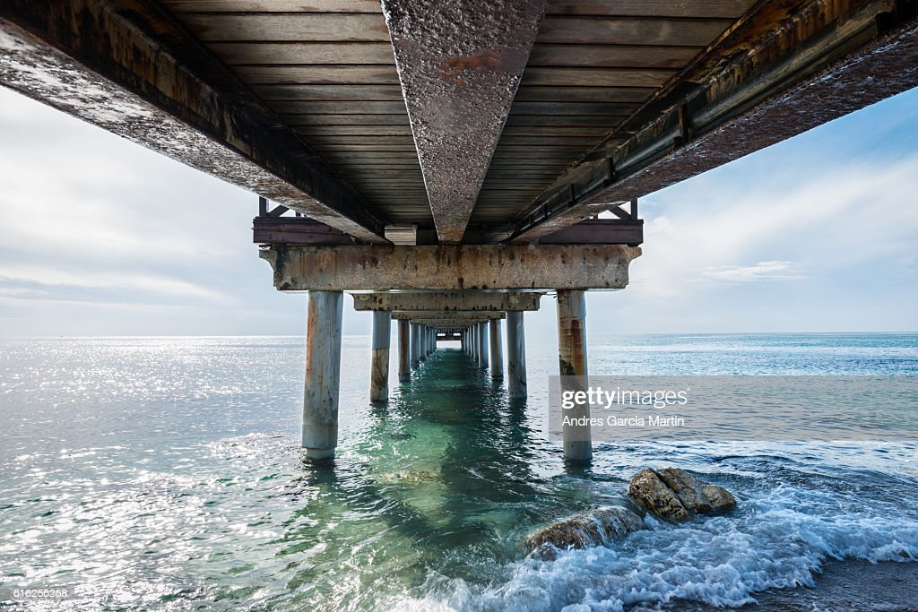 Under the jetty in Marbella at midday : Stock Photo
