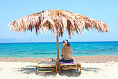 Under the parasol. Skiathos, Greece