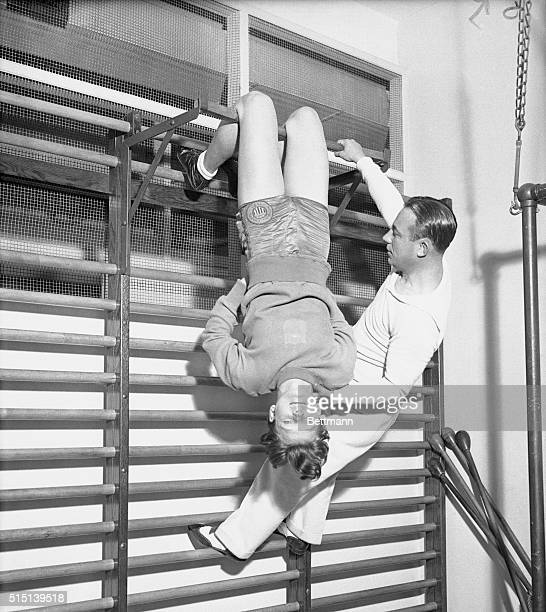 Under the personal direction of Artie McGovern Mildred 'Babe' Didrickson the sensational girl athlete of Beaumont Texas trains in McGovern's Gym in...