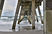 Under a fishing pier at Wrightsville Beach, NC.