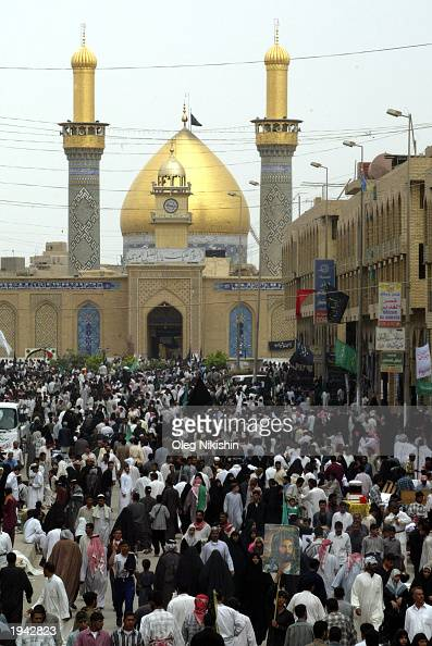 Under the shadow of the Mosque of Imam Abbas hundreds of thousands of Muslim Shias make their entrance into one of Iraq's holiest cities in a...