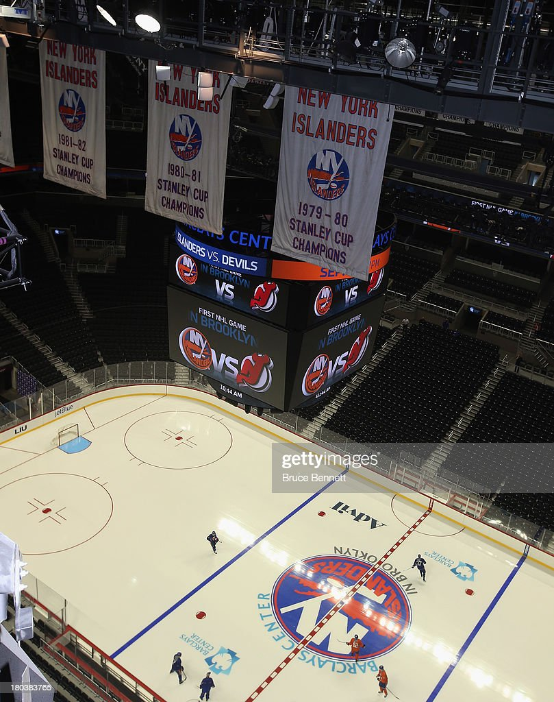Under the Stanley Cup banners, the New York Islanders take part in their first practice at the Barclays Center on September 12, 2013 in Brooklyn borough of New York City. The Islanders are due to move into the building for the 2015-16 season.