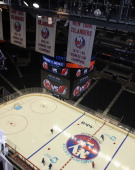 Under the Stanley Cup banners the New York Islanders take part in their first practice at the Barclays Center on September 12 2013 in Brooklyn...