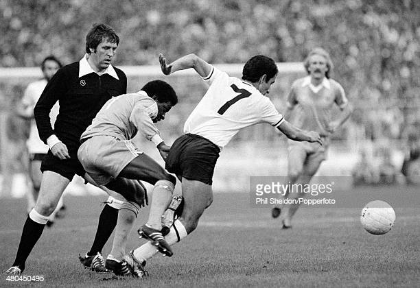 Under the watchful gaze of referee Keith Hackett Osvaldo Ardiles of Tottenham Hotspur moves away from Manchester City winger David Bennett during the...