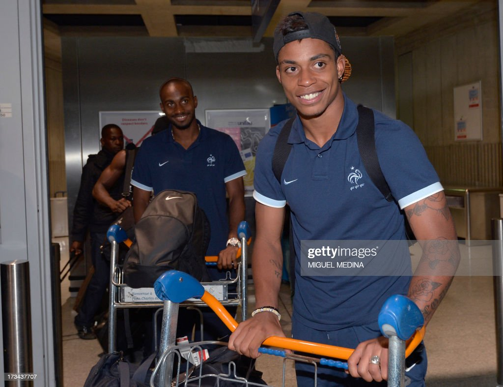 Under-20 French team defender Dimitri Foulquier (L) and forward Jean-Christophe Bahebeck arrive with teammates at the Roissy-Charles-de-Gaulle airport, on July 14, 2013, a day after defeating Uruguay during their FIFA Under 20 World Cup final football match in Istanbul. France won the title after defeating Uruguay 4-1 on penalties following a goalless draw.