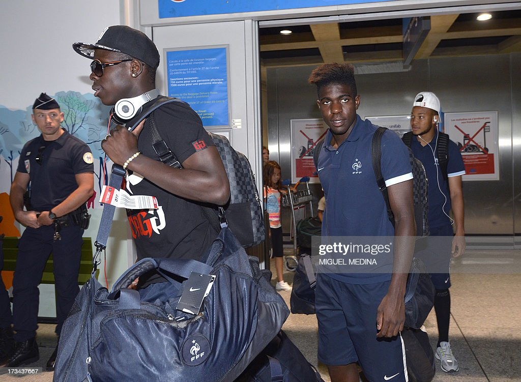 Under-20 French team defenders Kurt Zouma (L) Samuel Umtiti (C) and Pierre-Yves Polomat (R) arrive with teammates at the Roissy-Charles-de-Gaulle airport, on July 14, 2013, a day after defeating Uruguay during their FIFA Under 20 World Cup final football match in Istanbul. France won the title after defeating Uruguay 4-1 on penalties following a goalless draw.