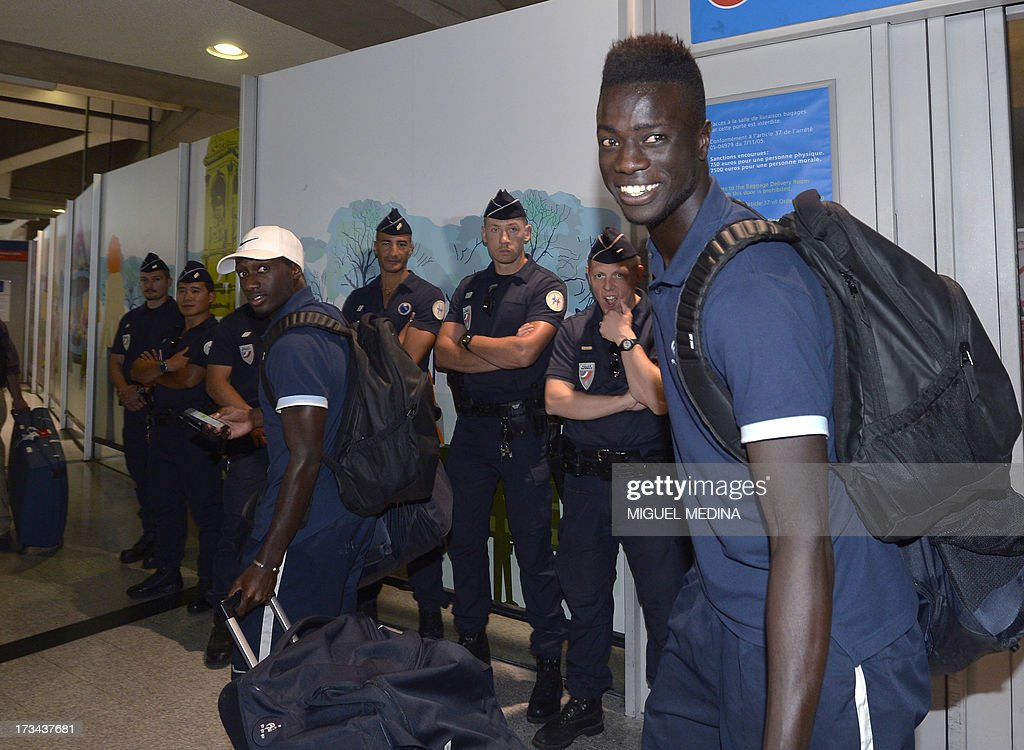 Under-20 French team defenders Youssou Sabaly (L) and Mouhamadou Naby Sarr arrive with teammates at the Roissy-Charles-de-Gaulle airport, on July 14, 2013, a day after defeating Uruguay during their FIFA Under 20 World Cup final football match in Istanbul. France won the title after defeating Uruguay 4-1 on penalties following a goalless draw.