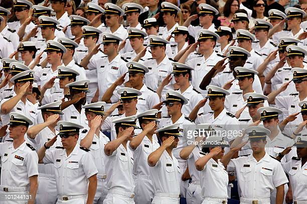 Underclass midshipmen stand and salute for the National Anthem during the graduation ceremony at the United States Naval Academy May 28 2010 in...