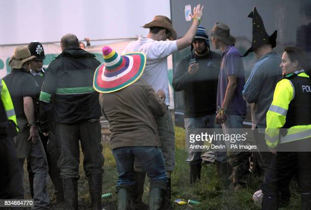 Undercover police officers perform a stop and search during the 2008 Glastonbury Festival
