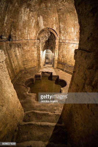 Underground stone chamber holding water