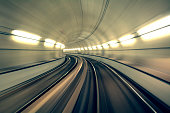 Underground train is speeding fast in a tunnel
